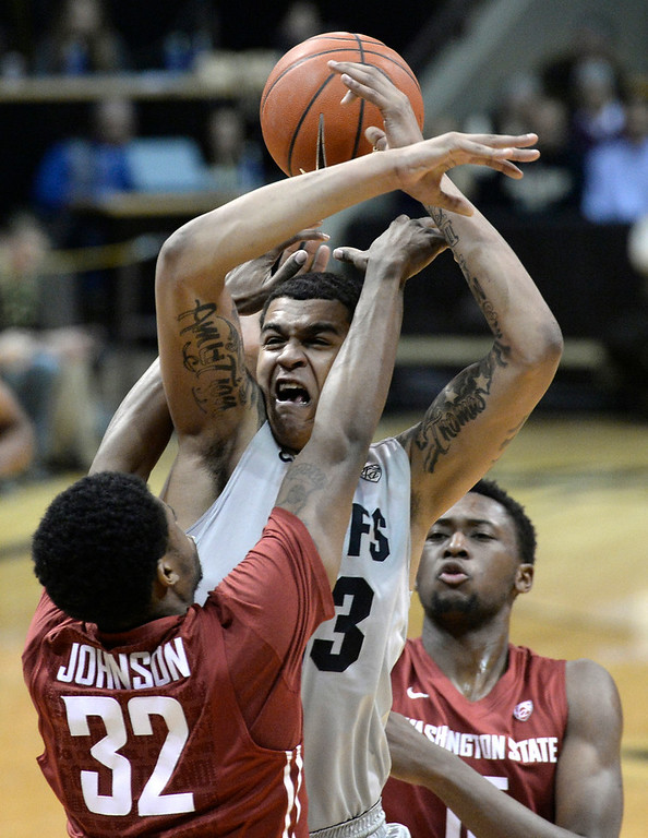. Colorado\'s Dustin Thomas gets hit shot blocked by Que Johnson during an NCAA game against Washington State on Wednesday, Feb. 5, at the Coors Event Center in Boulder.  Jeremy Papasso/ Camera