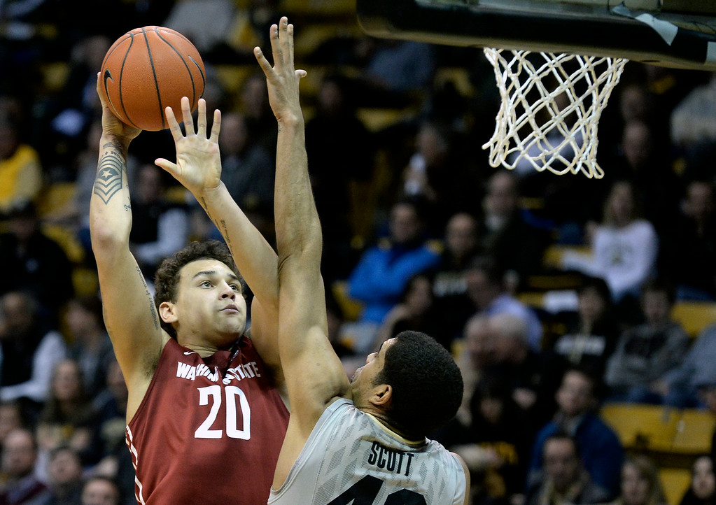 . Washington State\'s Jordan Railey takes a shot over Josh Scott during an NCAA game against Colorado on Wednesday, Feb. 5, at the Coors Event Center in Boulder.  Jeremy Papasso/ Camera