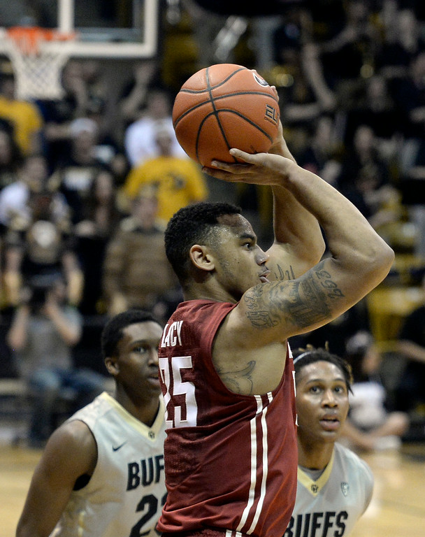 . Washington State\'s Davonte Lacy takes a shot in front of Xavier Johnson and Jaron Hopkins  during an NCAA game against Colorado on Wednesday, Feb. 5, at the Coors Event Center in Boulder.  Jeremy Papasso/ Camera