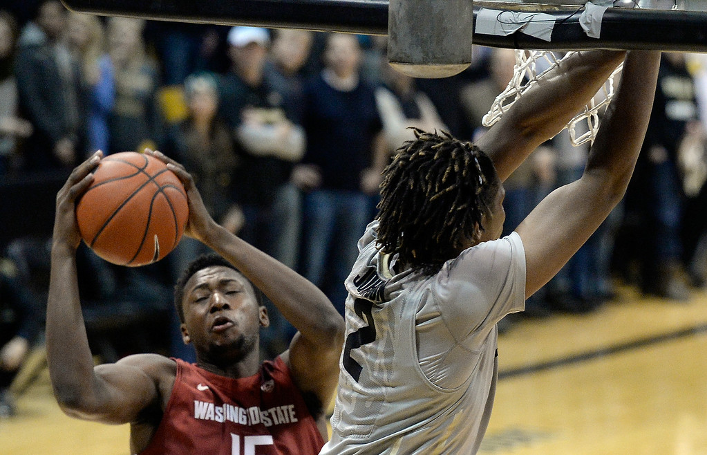 . Washington State\'s Junior Longrus snags a rebound after Xavier Johnson misses a dunk during an NCAA game against Colorado on Wednesday, Feb. 5, at the Coors Event Center in Boulder.  Jeremy Papasso/ Camera