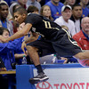 Colorado guard Xavier Talton (3) dives into the crowd to save a ball from going foul during the first half of an NCAA college basketball game against Kansas Saturday, Dec. 8, 2012, in Lawrence, Kan. (AP Photo/Charlie Riedel)