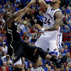 Kansas guard Travis Releford (24) gets past Colorado guard Jeremy Adams (31) to dunk the ball during the first half of an NCAA college basketball game Saturday, Dec. 8, 2012, in Lawrence, Kan. (AP Photo/Charlie Riedel)