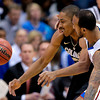 Kansas guard Travis Releford, right, pressures Colorado guard Spencer Dinwiddie (25) during the first half of an NCAA college basketball game Saturday, Dec. 8, 2012, in Lawrence, Kan. (AP Photo/Charlie Riedel)