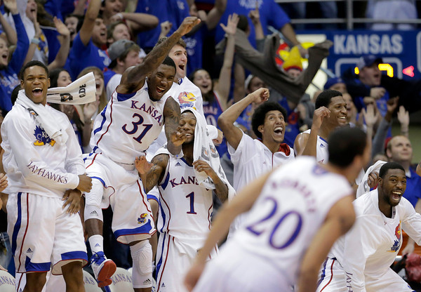 Kansas players celebrate a shot by guard Tyler Self in the final seconds of an NCAA college basketball game against Colorado Saturday, Dec. 8, 2012, in Lawrence, Kan. Kansas won the game 90-54. (AP Photo/Charlie Riedel)