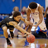 Kansas forward Kevin Young (40) and Colorado guard Askia Booker (0) chase a loose ball during the first half of an NCAA college basketball game Saturday, Dec. 8, 2012, in Lawrence, Kan. (AP Photo/Charlie Riedel)