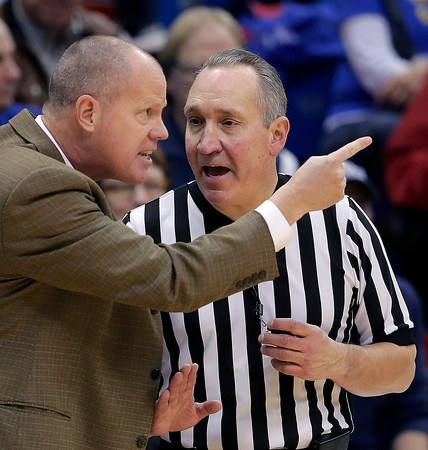 Colorado coach Tad Boyle disputes a call with an official during the first half of an NCAA college basketball game against Kansas Saturday, Dec. 8, 2012, in Lawrence, Kan. (AP Photo/Charlie Riedel)