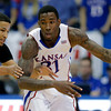Kansas forward Jamari Traylor (31) drives against Colorado forward Andre Roberson (21) during the first half of an NCAA college basketball game Saturday, Dec. 8, 2012, in Lawrence, Kan. (AP Photo/Charlie Riedel)