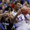 Kansas guard Ben McLemore (23) beats Colorado guard Xavier Talton (3) to a rebound during the first half of an NCAA college basketball game Saturday, Dec. 8, 2012, in Lawrence, Kan. (AP Photo/Charlie Riedel)