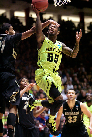 NCAA Colorado Baylor Ba(7).JPG Baylor guard Pierre Jackson (55) drives against Colorado forward Andre Roberson during the second half of an NCAA tournament third-round college basketball game on Saturday, March 17, 2012, in Albuquerque, N.M. Baylor won 80-63. (AP Photo/Jake Schoellkopf)