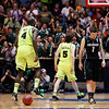 NCAA Colorado Baylor Ba(11).JPG Colorado guard Nate Tomlinson (1) walks offcourt as Baylor's Brady Heslip (5) and Quincy Acy (4) celebrate as time expires during the second half of an NCAA tournament third-round college basketball game on Saturday, March 17, 2012, in Albuquerque, N.M. Baylor won 80-63. (AP Photo/Matt York)