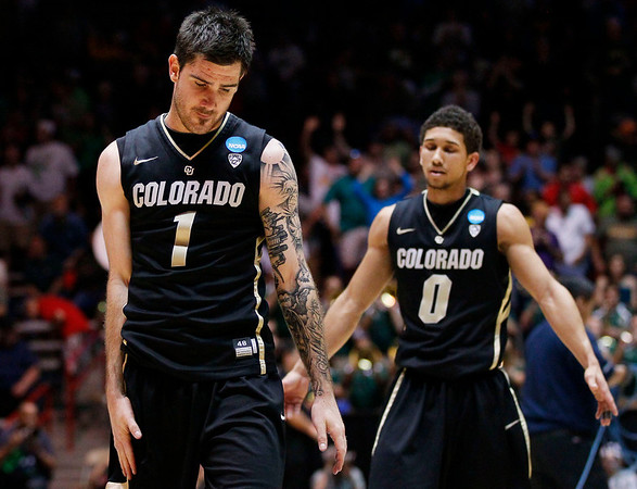NCAA Colorado Baylor Ba(3).JPG Colorado's Nate Tomlinson (1) and Askia Booker (0) walk to the bench as time expires during the second half of an NCAA tournament third-round college basketball game against Baylor, Saturday, March 17, 2012, in Albuquerque, N.M. Baylor won 80-63. (AP Photo/Matt York)