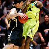 NCAA Colorado Baylor Ba(21).JPG Colorado guard Nate Tomlinson, left, and Baylor guard Deuce Bello try to avoid contact during the first half of an NCAA tournament third-round college basketball game on Saturday, March 17, 2012, in Albuquerque, N.M. (AP Photo/Matt York)