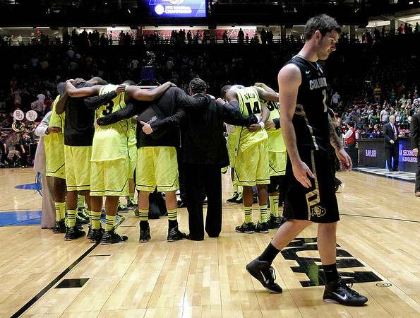 NCAA Colorado Baylor Ba(2).JPG Colorado guard Nate Tomlinson leaves the court as Baylor players huddle after an NCAA men's college basketball tournament third-round game Saturday, March 17, 2012, in Albuquerque, N.M. Baylor won 80-63. (AP Photo/Matt York)