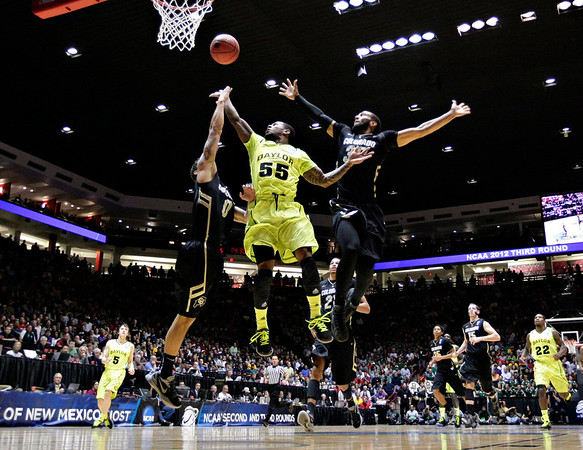 NCAA Colorado Baylor Ba(17).JPG Baylor guard Pierre Jackson (55) shoots between Colorado defenders Nate Tomlinson, left, and Carlon Brown, right, during the first half of an NCAA tournament third-round college basketball game on Saturday, March 17, 2012, in Albuquerque, N.M. (AP Photo/Matt York)