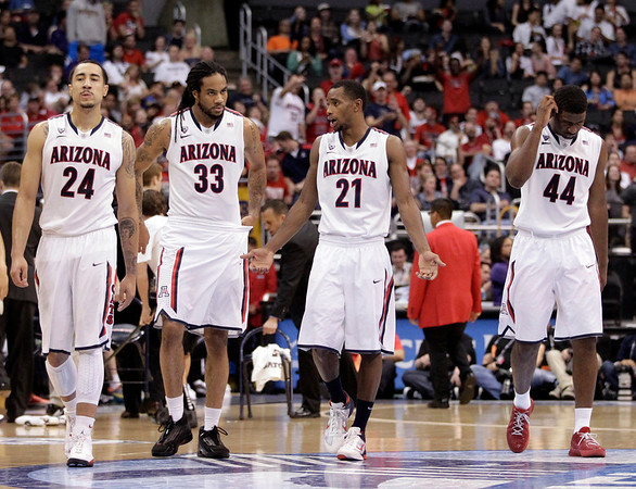 P12 Colorado Arizona Ba(3).JPG Arizona's Brendon Lavender, from left, Jesse Perry, Kyle Fogg and Solomon Hill walk up the court during the second half of an NCAA college basketball game in the finals of the Pac-12 conference championship in Los Angeles, Saturday, March 10, 2012. Colorado won 53-51. (AP Photo/Jae C. Hong)