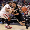 P12 Colorado Arizona Basket.JPG Colorado's Nate Tomlinson, right, is defended by Arizona's Jordin Mayes during the second half of an NCAA college basketball game in the finals of the Pac-12 conference championship in Los Angeles, Saturday, March 10, 2012. (AP Photo/Jae C. Hong)