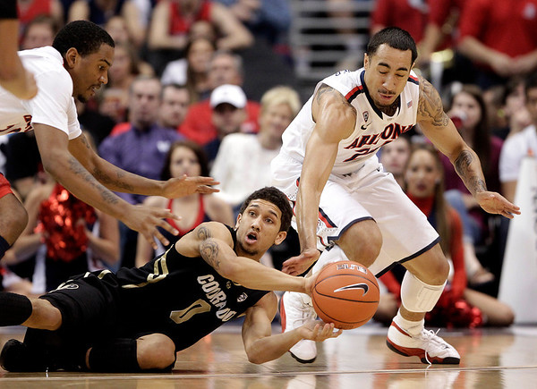 P12 Colorado Arizona Ba(5).JPG Colorado's Askia Booker, center, looks to pass after retrieving a loose ball against Arizona's Jordin Mayes, left, and Brendon Lavender during the first half of an NCAA college basketball game in the finals of the Pac-12 conference championship in Los Angeles, Saturday, March 10, 2012. (AP Photo/Jae C. Hong)