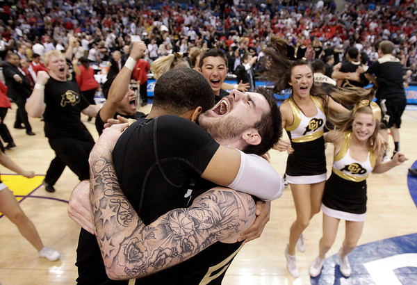 APTOPIX P12 Colorado Arizon.JPG Colorado's Nate Tomlinson, right, and teammate Carlon Brown celebrate their team's 53-51 win over Arizona after their NCAA college basketball game in the finals of the Pac-12 conference championship in Los Angeles, Saturday, March 10, 2012. (AP Photo/Jae C. Hong)