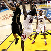 P12 Colorado Arizona Basket.JPG Colorado's Carlon Brown, left, drives to the basket as he is defended by Arizona's Angelo Chol, center, during the first half of an NCAA college basketball game in the finals of the Pac-12 conference championship in Los Angeles, Saturday, March 10, 2012. (AP Photo/Jae C. Hong)