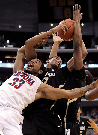P12 Colorado Arizona Ba(6).JPG Arizona's Jesse Perry, left, and Colorado's Andre Roberson fight for a rebound during the first half of an NCAA college basketball game in the finals of the Pac-12 conference championship in Los Angeles, Saturday, March 10, 2012. (AP Photo/Jae C. Hong)
