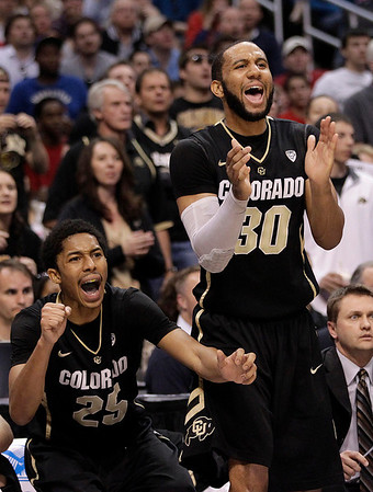 P12 Colorado Arizona Ba(2).JPG Colorado's Carlon Brown, right, and teammate Spencer Dinwiddie reacts to a play during the second half of an NCAA college basketball game against Arizona in the finals of the Pac-12 conference championship in Los Angeles, Saturday, March 10, 2012. (AP Photo/Jae C. Hong)