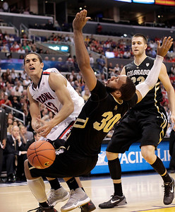 P12 Colorado Arizona Ba(2).JPG Colorado's Carlon Brown, center, fouls Arizona's Nick Johnson, left, during the first half of an NCAA college basketball game in the finals of the Pac-12 conference championship in Los Angeles, Saturday, March 10, 2012. (AP Photo/Jae C. Hong)