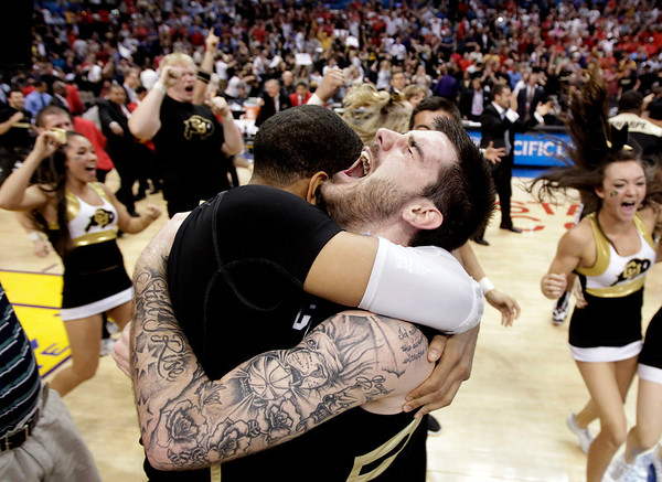 P12 Colorado Arizona Ba(3).JPG Colorado's Nate Tomlinson, right, and Carlon Brown celebrate their team's 53-51 win over Arizona after their NCAA college basketball game in the finals of the Pac-12 conference championship in Los Angeles, Saturday, March 10, 2012. Colorado won 53-51. (AP Photo/Jae C. Hong)