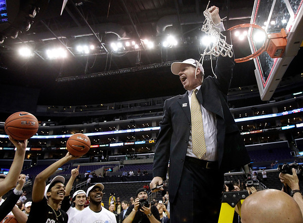 P12 Colorado Arizona Ba(2).JPG Colorado head coach Tad Boyle, right, and his team celebrate the team's 53-51 win over Arizona after an NCAA college basketball game in the finals of the Pac-12 conference championship in Los Angeles, Saturday, March 10, 2012. (AP Photo/Jae C. Hong)