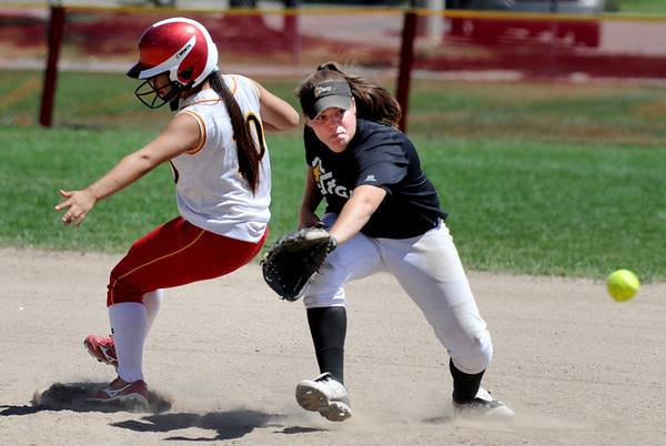 "Alyssa Summit, left, of the Desperados gets to second before the throw to Carlie Sexton of the Stars.<br /> For more photos of the game, go to  <a href=""http://www.dailycamera.com"">http://www.dailycamera.com</a>. or  <a href=""http://www.timescall.com"">http://www.timescall.com</a>.<br /> Cliff Grassmick / June 17, 2012"