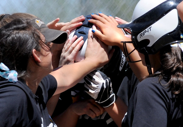"Mallory Paulson, center covered with hands, of the Colorado Stars hit a home run to help her team beat the California Stars and qualify for nationals.<br /> For more photos of the game, go to  <a href=""http://www.dailycamera.com"">http://www.dailycamera.com</a>. or  <a href=""http://www.timescall.com"">http://www.timescall.com</a>.<br /> Cliff Grassmick / June 17, 2012"