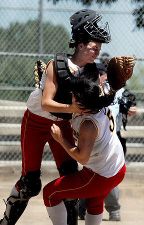 "Dani Doucette, left, and Tonia Wu, both of the Desperados, collide going for a pop up against the Colorado Stars on Sunday.<br /> For more photos of the game, go to  <a href=""http://www.dailycamera.com"">http://www.dailycamera.com</a>. or  <a href=""http://www.timescall.com"">http://www.timescall.com</a>.<br /> Cliff Grassmick / June 17, 2012"