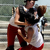 """Dani Doucette, left, and Tonia Wu, both of the Desperados, collide going for a pop up against the Colorado Stars on Sunday.<br /> For more photos of the game, go to  <a href=""""http://www.dailycamera.com"""">http://www.dailycamera.com</a>. or  <a href=""""http://www.timescall.com"""">http://www.timescall.com</a>.<br /> Cliff Grassmick / June 17, 2012"""