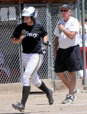"Mallory Paulson of the Colorado Stars hit a home run to help her team beat the California Stars and qualify for nationals. Coach Dan Burns is on the right.<br /> For more photos of the game, go to  <a href=""http://www.dailycamera.com"">http://www.dailycamera.com</a>. or  <a href=""http://www.timescall.com"">http://www.timescall.com</a>.<br /> Cliff Grassmick / June 17, 2012"