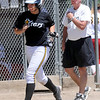 """Mallory Paulson of the Colorado Stars hit a home run to help her team beat the California Stars and qualify for nationals. Coach Dan Burns is on the right.<br /> For more photos of the game, go to  <a href=""""http://www.dailycamera.com"""">http://www.dailycamera.com</a>. or  <a href=""""http://www.timescall.com"""">http://www.timescall.com</a>.<br /> Cliff Grassmick / June 17, 2012"""