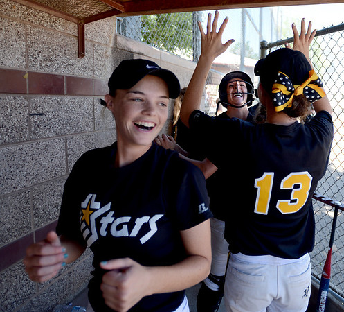 "Mallory Paulson, center, of the Colorado Stars hit a home run to help her team beat the California Stars and qualify for nationals. <br />  Michaela Good is on the left, and Sara Good is giving her high fives.<br /> For more photos of the game, go to  <a href=""http://www.dailycamera.com"">http://www.dailycamera.com</a>. or  <a href=""http://www.timescall.com"">http://www.timescall.com</a>.<br /> Cliff Grassmick / June 17, 2012"