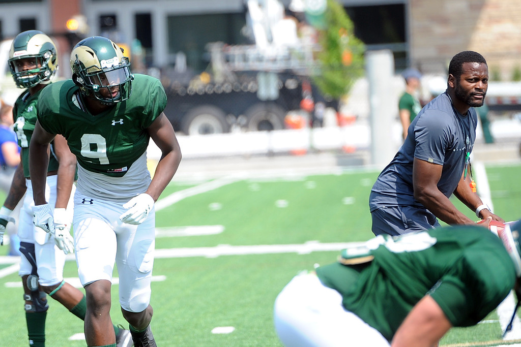 . Colorado State receiver Warren Jackson (9) runs a drill with receivers coach Alvis Whitted during practice Monday, Aug. 7, 2018 in Fort Collins, Colorado. (Sean Star/Loveland Reporter-Herald)
