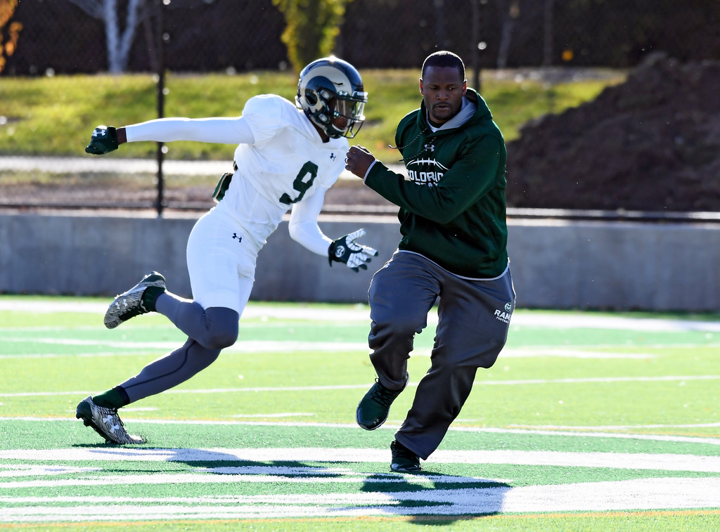 . FORT COLLINS, CO - OCTOBER 24: CSU receivers coach Alvis Whitted works with wide receiver Warren Jackson (9) during practice on October 24, 2017 in Ft. Collins. Whitted has now developed two NFL prospects with the CSU Rams. (Photo by John Leyba/The Denver Post)