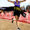 """Boulder High School senior Kelsey Lakowske crosses the finish line to clench the womens Class 5A title during the Colorado X-Country State Championship on Saturday, Oct. 30, at the Arapahoe County Fairgrounds in Aurora.<br /> For more photos go to  <a href=""""http://www.dailycamera.com"""">http://www.dailycamera.com</a><br /> Jeremy Papasso/ Camera"""