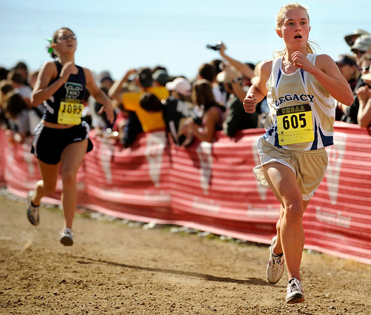 "Legacy High School sophomore Melanie Nun finishes in 22nd place during the women's Class 5A Colorado X-Country State Championship on Saturday, Oct. 30, at the Arapahoe County Fairgrounds in Aurora.<br /> For more photos go to  <a href=""http://www.dailycamera.com"">http://www.dailycamera.com</a><br /> Jeremy Papasso/ Camera"