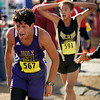 """Holy Family High School senior Andres Rodriquez, left, shows his exhaustion after finishing in 84th place during the mens Class 3A Colorado X-Country State Championship on Saturday, Oct. 30, at the Arapahoe County Fairgrounds in Aurora.<br /> For more photos go to  <a href=""""http://www.dailycamera.com"""">http://www.dailycamera.com</a><br /> Jeremy Papasso/ Camera"""