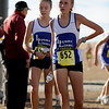 "Lyons High School sophomore Kelsey Miner, right, and junior Izzy Solman walk together after crossing the finish line during the Colorado X-Country State Championship on Saturday, Oct. 30, at the Arapahoe County Fairgrounds in Aurora.<br /> For more photos go to  <a href=""http://www.dailycamera.com"">http://www.dailycamera.com</a><br /> Jeremy Papasso/ Camera"