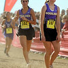 """Boulder High School sophomore Madi Lohmann uses her last bit of energy to cross the finish line in 115th place just behind senior teammate Katie Boncella, left, who finished in 107th place during the women's Class 5A Colorado X-Country State Championship on Saturday, Oct. 30, at the Arapahoe County Fairgrounds in Aurora.<br /> For more photos go to  <a href=""""http://www.dailycamera.com"""">http://www.dailycamera.com</a><br /> Jeremy Papasso/ Camera"""