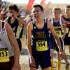 """Holy Family sophomore Sean Ankarlo shows his exhaustion after finishing in 27th place during the mens Class 3A Colorado X-Country State Championship on Saturday, Oct. 30, at the Arapahoe County Fairgrounds in Aurora.<br /> For more photos go to  <a href=""""http://www.dailycamera.com"""">http://www.dailycamera.com</a><br /> Jeremy Papasso/ Camera"""