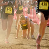 """Boulder High School sophomore Madi Lohmann tries to get back on her feet after collapsing near the finish line during the women's Class 5A Colorado X-Country State Championship on Saturday, Oct. 30, at the Arapahoe County Fairgrounds in Aurora. Lohmann finished in 115th place.<br /> For more photos go to  <a href=""""http://www.dailycamera.com"""">http://www.dailycamera.com</a><br /> Jeremy Papasso/ Camera"""