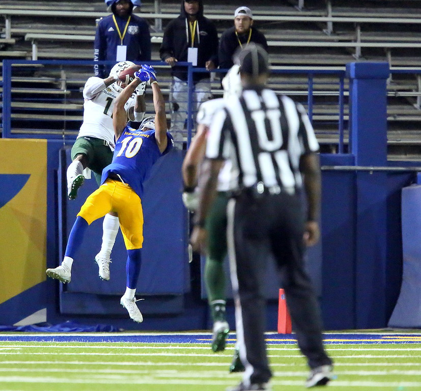 . Colorado State safety  Jordan Fogal intercepts a pass over San Jose State receiver Tre Walker iin Saturday\'s 42-30 win for the Rams. (Ron Fried/For the Reporter-Herald)