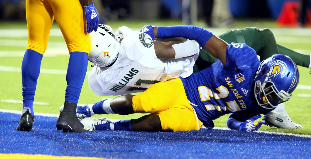 . Colorado State receiever Preston Williams rolls over San Jose State\'s Jonathan Lenard Jr. into the end zone for his second touchdown  during Saturday\'s game with San Jose State at CEFCU Stadium. (Ron Fried/For the Reporter-Herald)