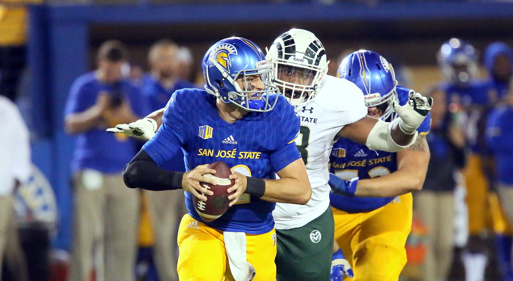 . Colorado State defensive tackles goes in for a sack of San Jose State quarterback Josh Love in the Rams\' 42-30 victory over the Spartans on Saturday  night. (Ron Fried/For the Reporter-Herald)