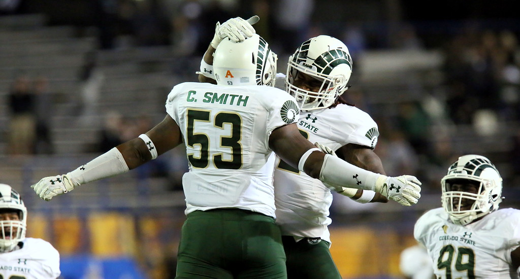 . Colorado State defensive end Caleb Smith celebrates a sack with linebacker Tre Thomas during Saturday\'s game with San Jose State at CEFCU Stadium. (Ron Fried/For the Reporter-Herald)