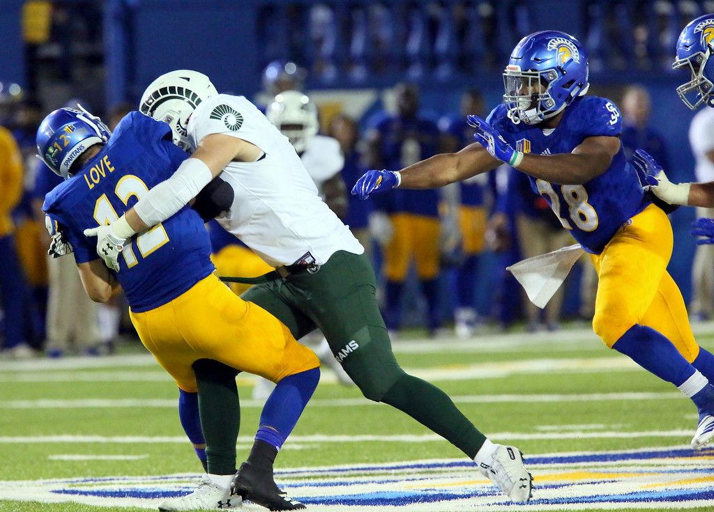 . Colorado State defensive end Jan-Phillip Bombek wraps up San Jose State quarterback for his third sack in Saturday\'s 42-30 victory for the Rams. CSU had six sacks in the game after having only two all season. (Ron Fried/For the Reporter-Herald)