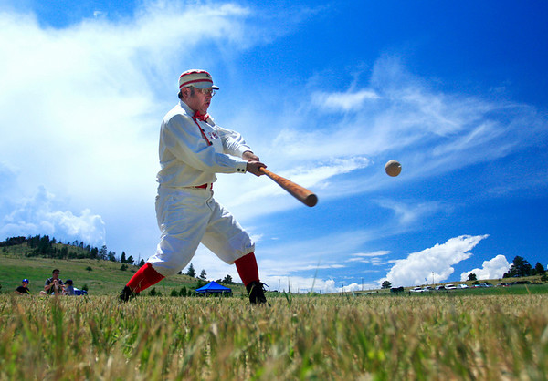 Roger 'Digger' Hadix connects for a two-bagger during the vintage baseball game between the Walker Ranch Boys and The Excelsiors at Walker Ranch in Boulder on July 25.<br /> Greg Lindstrom / The Camera